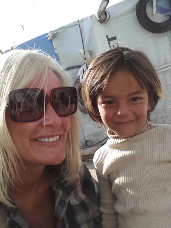 H.O.P.E Tara with one of the children of Syria - courtesy of bazaar.town